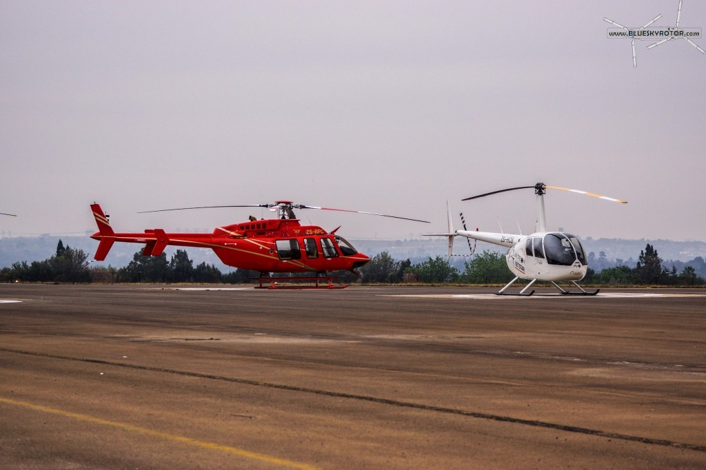 Bell 407 and R44 at FAGC airport, Gauteng province, South Africa