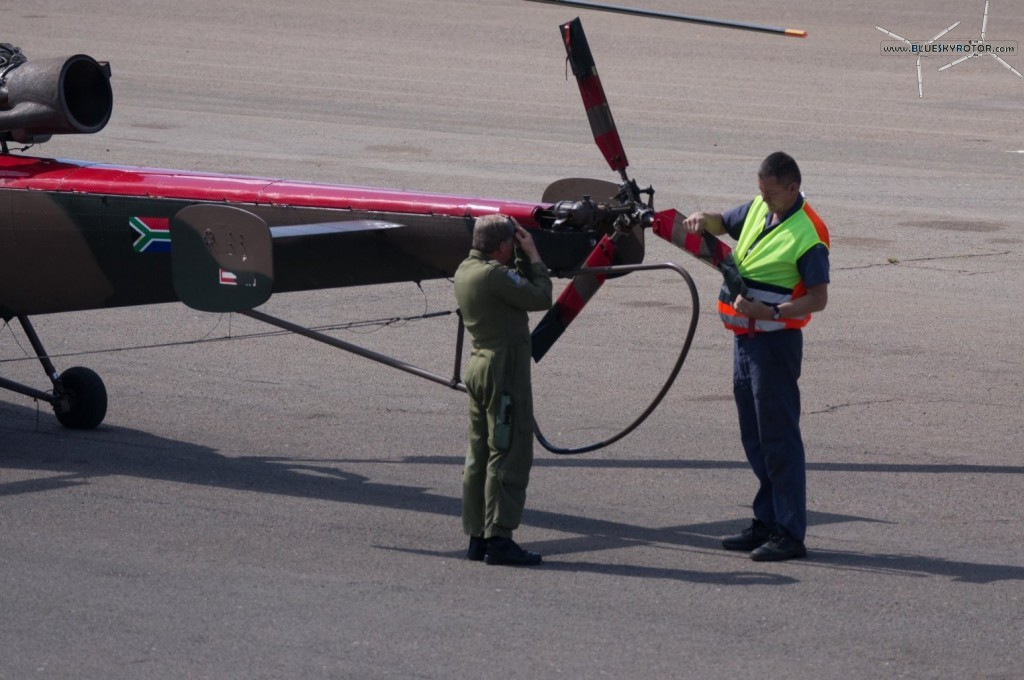 Alouette III after flight inspection with a pilot getting pretty