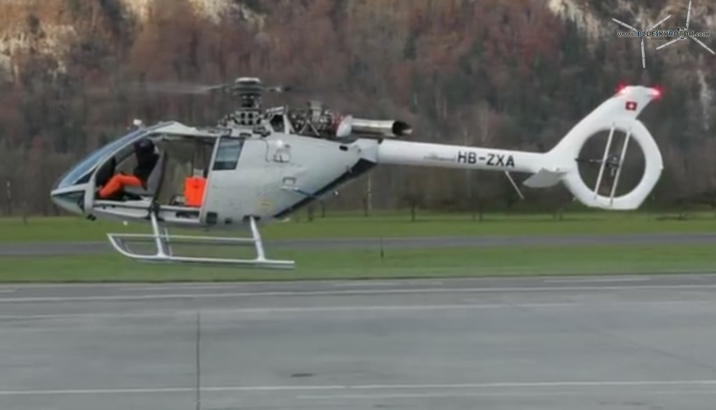 Left side of HB-ZXA, engine compartment open, of the Marenco SwissHelicopter SKYe SH09